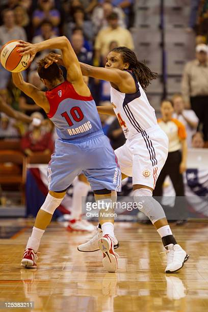 Tan White of the Connecticut Sun fouls Lindsey Harding of the Atlanta Dream late in Game One of the Eastern Conference Semifinals during the 2011...