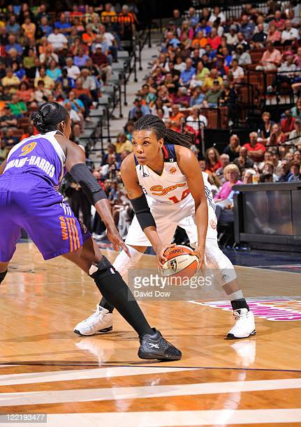 Tan White of the Connecticut Sun prepares to drive the basketball against Marie FerdinandHarris of the Phoenix Mercury on August 26 2011 at the...