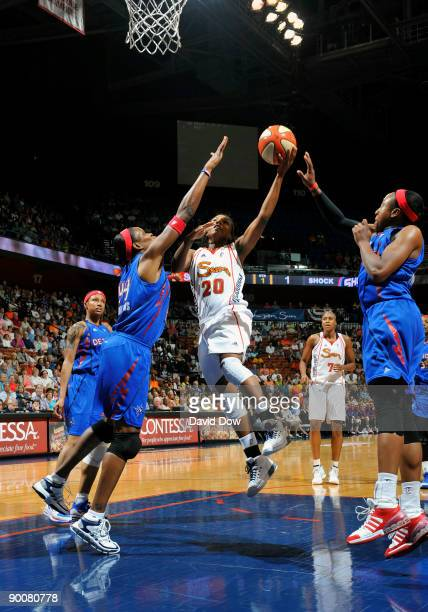 Tan White of the Connecticut Sun shoots the basketball against Taj McWilliams of the Detroit Shock during the WNBA game on August 25 2009 at the...