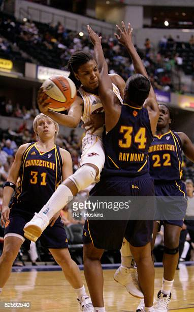 Tan White of the Indiana Fever battles Tamika Raymond of the Connecticut Sun at Conseco Fieldhouse on August 28 2008 in Indianapolis Indiana NOTE TO...