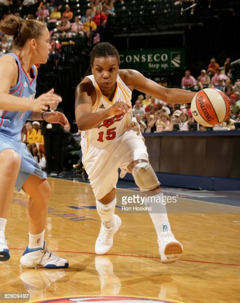 Tan White of the Indiana Fever drives on Kristin Haynie of the Atlanta Dream at Conseco Fieldhouse on August 30 2008 in Indianapolis Indiana NOTE TO...