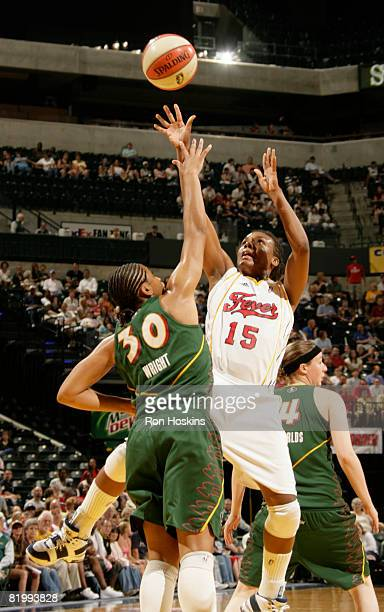 Tan White of the Indiana Fever shoots over Tanisha Wright of the Seattle Storm at Conseco Fieldhouse on July 18 2008 in Indianapolis Indiana NOTE TO...