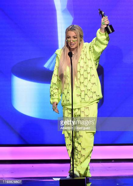 Tana Mongeau accepts an award onstage during The 9th Annual Streamy Awards on December 13 2019 in Los Angeles California