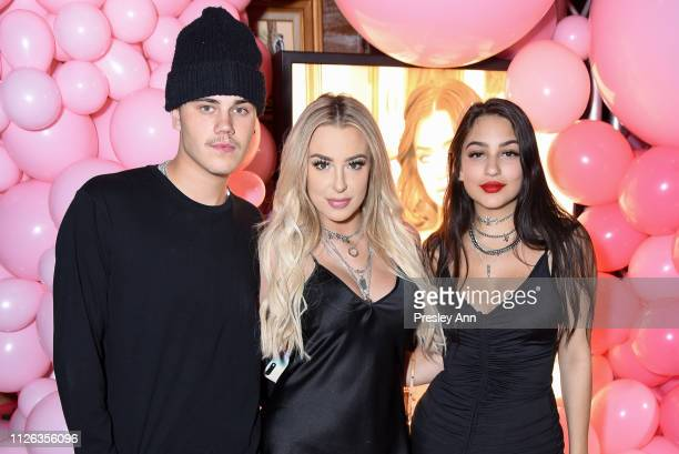 Tana Mongeau and guests attend Anastasia Karanikolaou For Oh Polly Valentine's Day Launch at Poppy on January 30 2019 in Los Angeles California