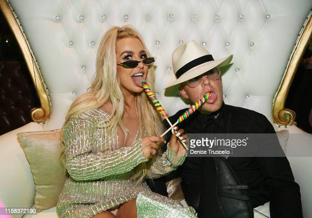 Tana Mongeau and Jake Paul celebrate at their wedding reception at Sweet Beginnings in Sugar Factory on July 28 2019 in Las Vegas Nevada