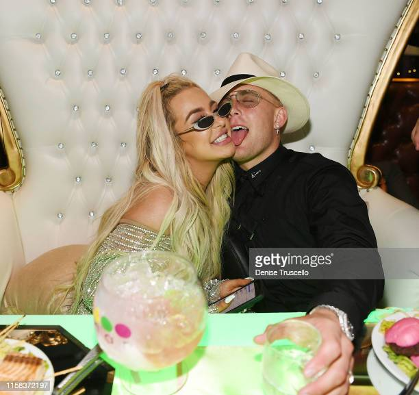 Tana Mongeau and Jake Paul celebrate at their wedding reception at Sweet Beginnings in Sugar Factory In Las Vegas on July 28 2019 in Las Vegas Nevada