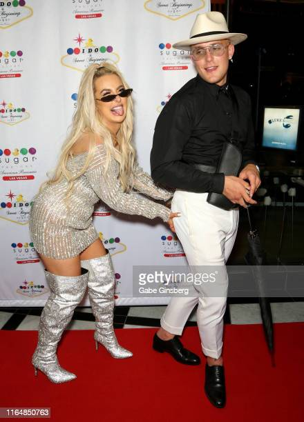Tana Mongeau and Jake Paul joke around during their wedding reception at the Sugar Factory American Brasserie at the Fashion Show mall on July 28...