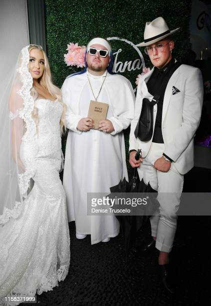 Tana Mongeau and Jake Paul pose for a photo with Arman Izadi during their wedding at Graffiti House on July 28 2019 in Las Vegas Nevada