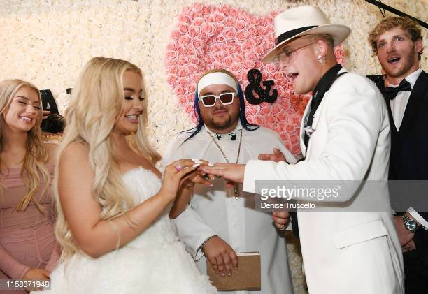 Tana Mongeau Arman Izadi Jake Paul and Logan Paul as Jake Paul and Tana Mongeau get married at Graffiti House on July 28 2019 in Las Vegas Nevada