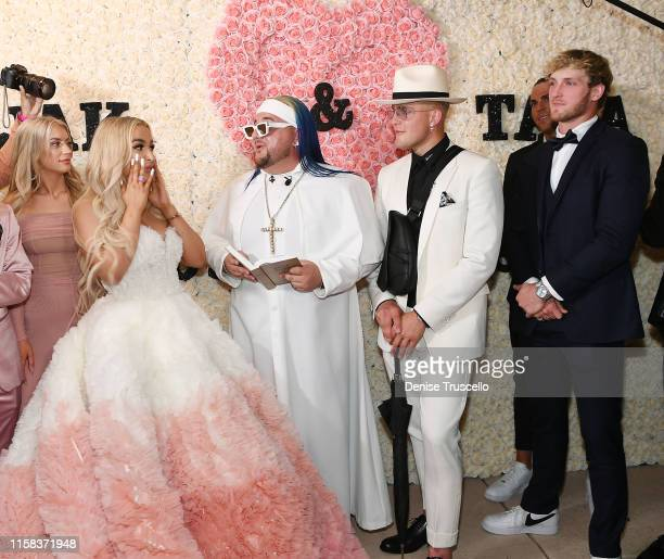 Tana Mongeau Arman Izadi Jake Paul and Logan Paul as Jake Paul and Tana Mongeau get married at Graffiti House on July 28 2019 in Las Vegas Nevada