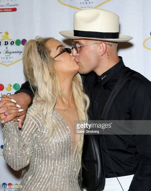 Tana Mongeau kisses Jake Paul during their wedding reception at the Sugar Factory American Brasserie at the Fashion Show mall on July 28 2019 in Las...