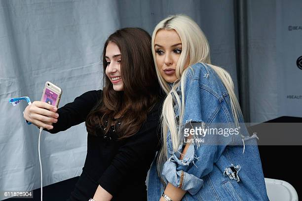 Tana Mongeau takes a selfie with a fan at the 3rd Annual Beautycon Festival New York at Pier 36 on October 1 2016 in New York City