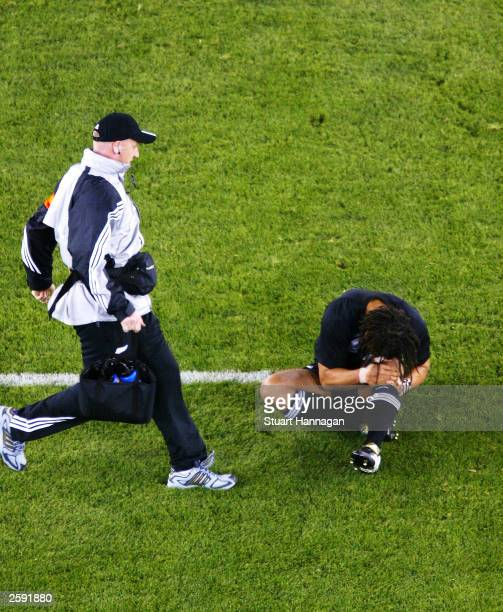 Tana Umaga of New Zealand holds his knee after falling awkwardly during the Rugby World Cup Pool D match between New Zealand and Italy at Telstra...