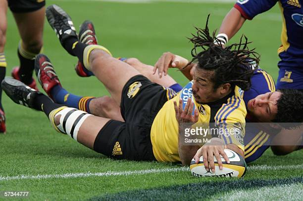 Tana Umaga of the Hurricanes presses the ball down to score a try during the round ten Super 14 match between the Highlanders and the Hurricanes at...