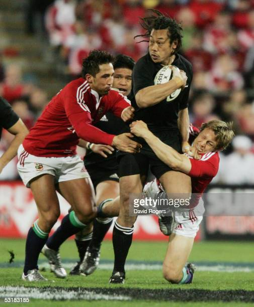 Tana Umaga the All Black captain is held by Jonny Wilkinson and Gavin Henson during the second test match between The New Zealand All Blacks and the...