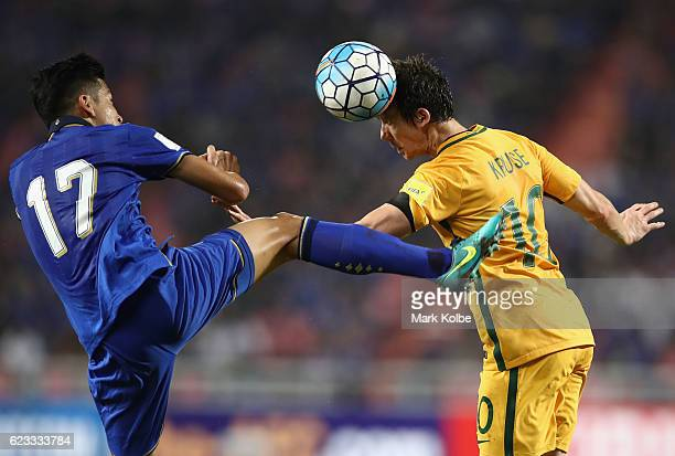 Tanaboon Kesarat of Thailand jumps to clear the ball as Robbie Kruse of the Socceroos heads the ball during the 2018 FIFA World Cup Qualifier match...