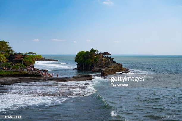 tanah lot is a rock formation off the indonesian island of bali - tanah lot stock pictures, royalty-free photos & images