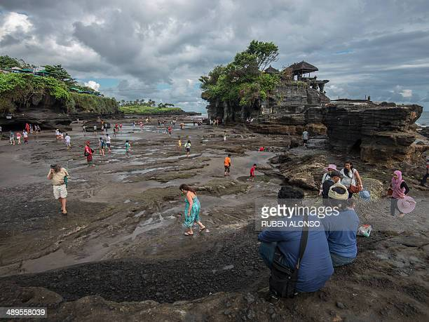 """Tanah Lot means """"Land [sic: in the] Sea"""" in the Balinese language.[2] Located in Tabanan, about 20 kilometres from Denpasar, the temple sits on a..."""