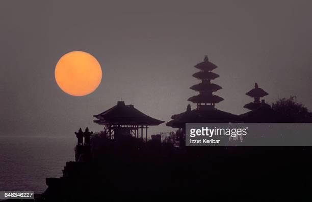 tanah lot temple at sunset,kuta beach,bali - tanah lot stock pictures, royalty-free photos & images