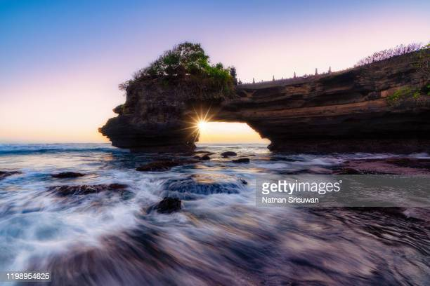 tanah lot temple in bali, indonesia. - tanah lot stock pictures, royalty-free photos & images