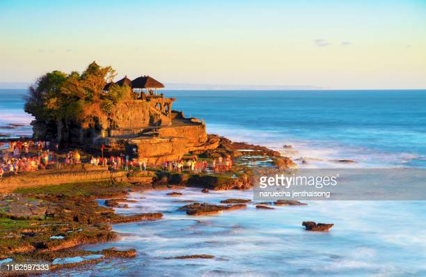 tanah lot temple in bali island indonesia. - balinese culture stock pictures, royalty-free photos & images