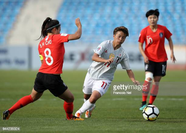 Tanaka Mina of Japan and Cho So Hyun of Korea in action during the AFC Women's Asian Cup Group B match between South Korea and Japan at the Amman...