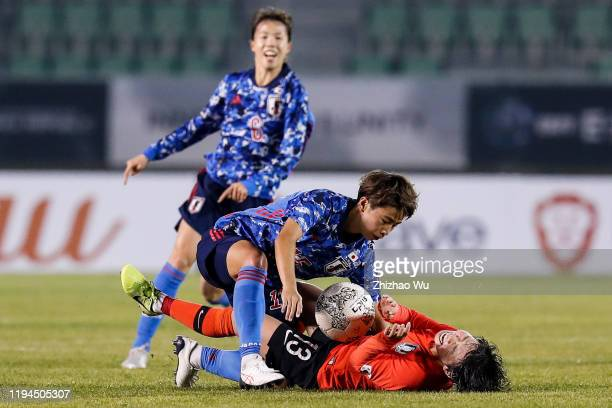 Tanaka Mina of Japan competes for the ball with Jang Chang of South Korea during the EAFF E1 Football Championship match between South Korea and...