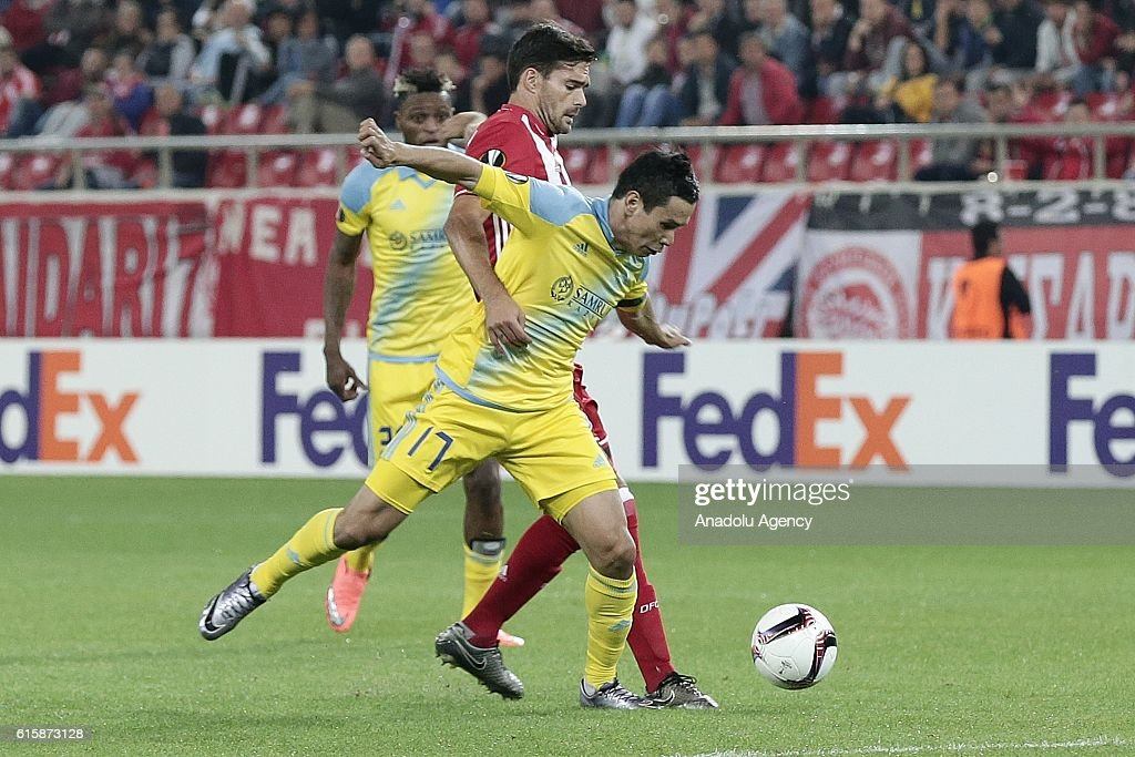 Tanat Nuserbayev (front) of Astana in action against his rival during the UEFA Europa League Group B football match between Olympiacos and Astana at Karaiskakis Stadium in Athens, Greece on October 20, 2016.
