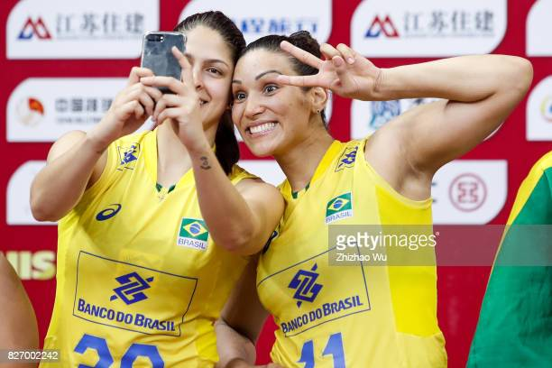 Tandara Caixeta and Ana Beatriz Correa of Brazil celebrate during the award ceremony 2017 Nanjing FIVB World Grand Prix Finals between Italy and...
