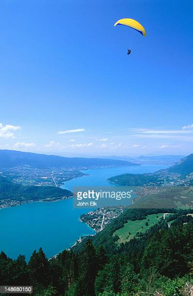 tandem hangliding over lake annecy. - lake annecy stock photos and pictures