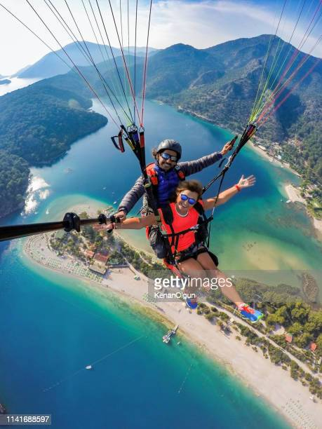 tandem jump in paragliding. - extreme sports stock pictures, royalty-free photos & images