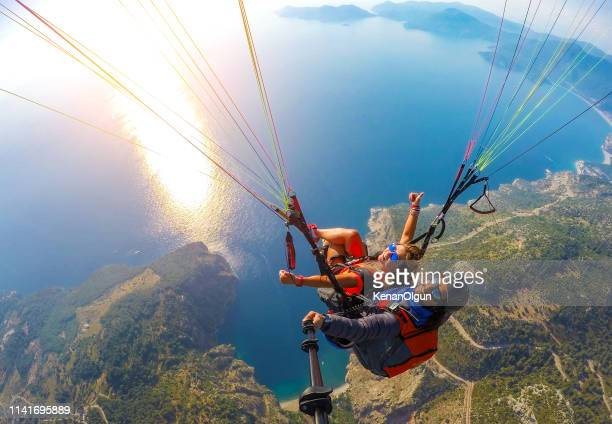tandem jump in paragliding. - gliding stock pictures, royalty-free photos & images
