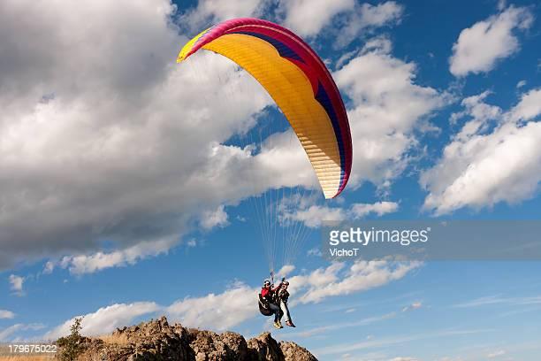 Tandem paraglider starting a flight