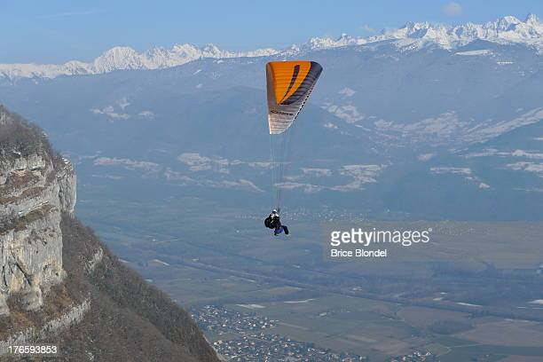 Tandem paragliding in the Alps .