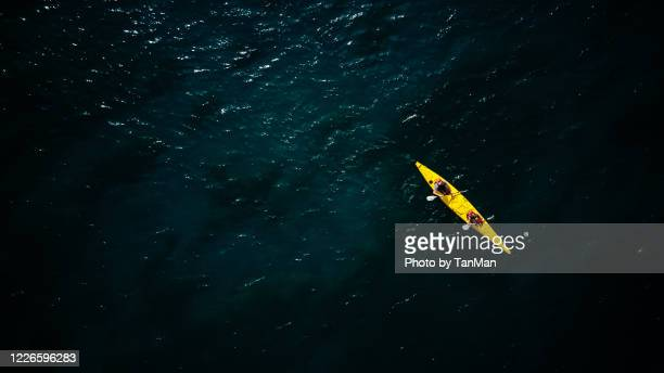 tandem yellow kayak in dark green waters of wanaka - travel stock pictures, royalty-free photos & images