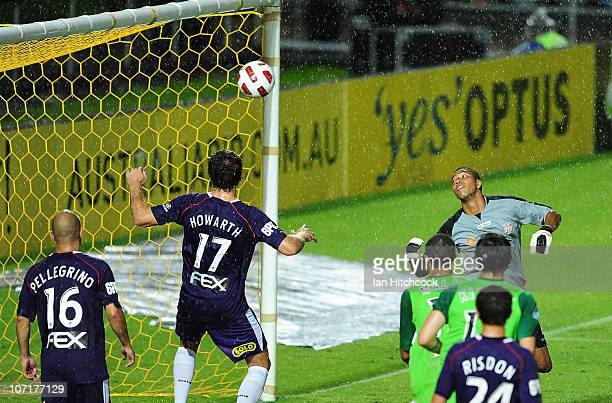 Tando Velaphi and Todd Howarth of the Glory watch the ball sail into the net for the equalising goal during the round 16 ALeague match between the...