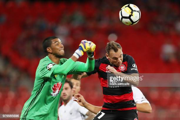 Tando Velaphi of the Phoenix punches the ball ahead of Brendon Santalab of the Wanderers during the round 22 ALeague match between the Western Sydney...