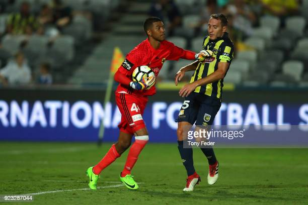 Tando Velaphi of the phoenix pushes Alan Baro of the Mariners during the round 21 ALeague match between the Central Coast Mariners and the Wellington...