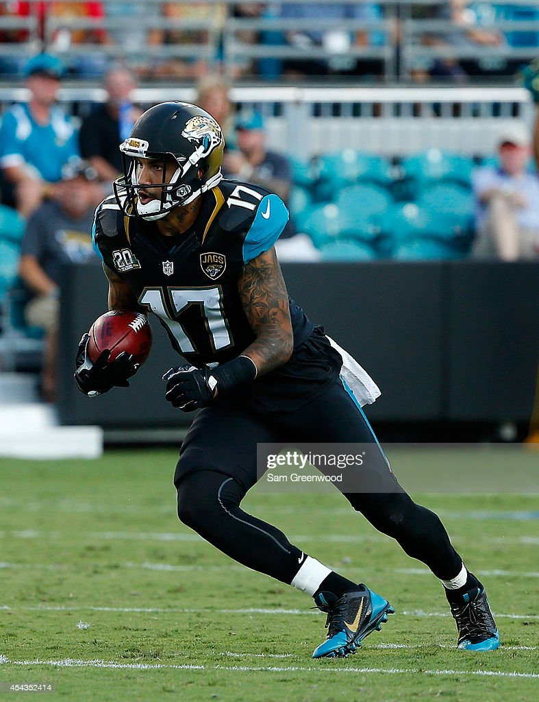 Tandon Doss #17 of the Jacksonville Jaguars runs for yardage during the preseason NFL game against the Atlanta Falcons at EverBank Field on August 28, 2014 in Jacksonville, Florida.