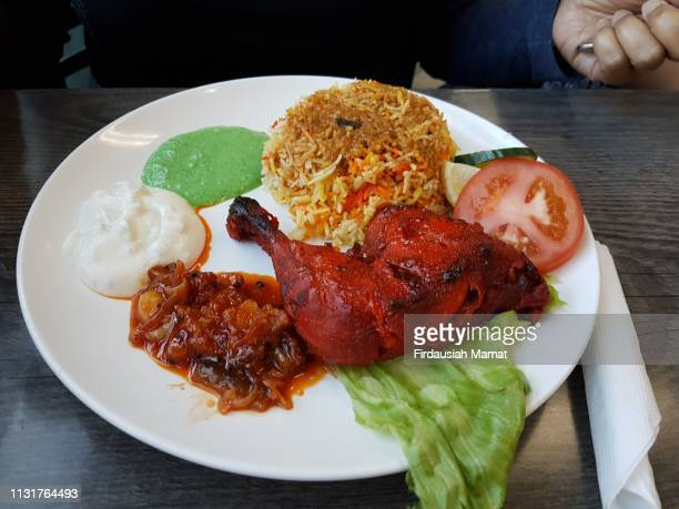 tandoori chicken with biryani - north indian food stock photos and pictures