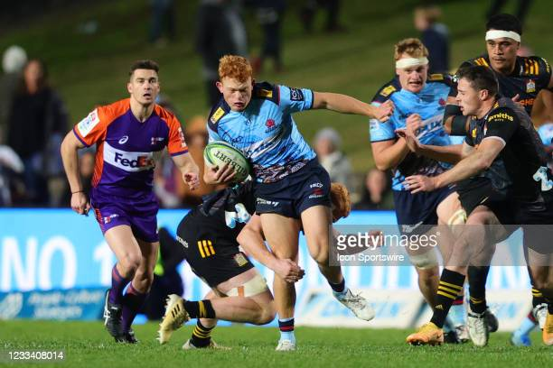 Tane Edmed of the Waratahs runs the ball during the round five Super Rugby Trans Tasman match between the NSW Waratahs and Chiefs at Brookvale Oval...