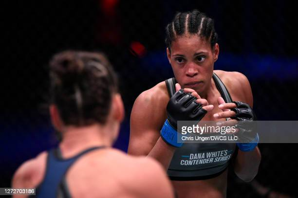 Taneisha Tennant looks to strike Danyelle Wolf in their women's featherweight bout during week seven of Dana White's Contender Series season four at...