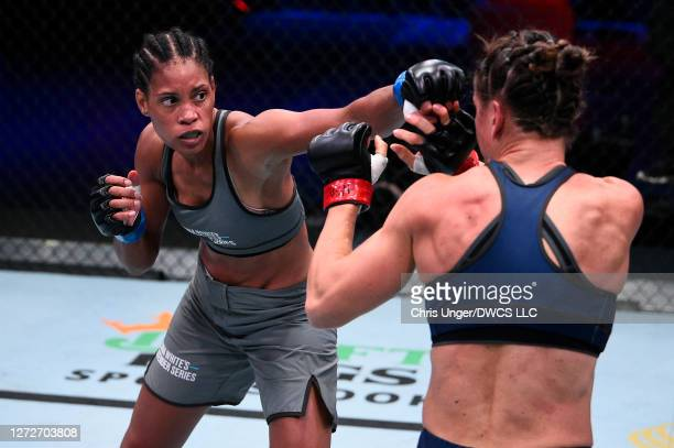 Taneisha Tennant punches Danyelle Wolf in their women's featherweight bout during week seven of Dana White's Contender Series season four at UFC APEX...