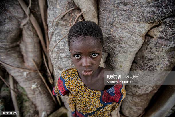 Taneka beri little girl with intense eyes in the atakora valley, north benin