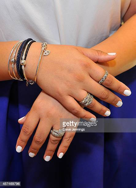 Tanesha Awasthi Fashion Lifestyle Blooger of Girl With Curves selects jewelry at Pandora's jewelry event at Westfield Valley Fair on October 18 2014...