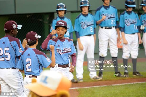 Taney Dragons pitcher Mo'ne Davis greets her teammates before the start of the game against Nevada at Lamade Stadium during the Little League World...