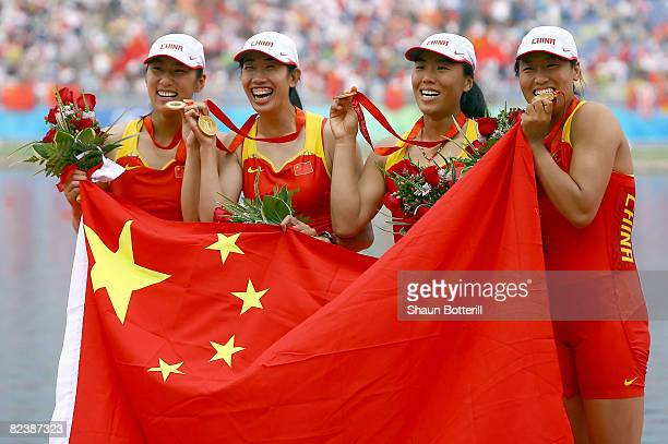 Tang Bin Jin Ziwei Xi Aihua and Zhang Yangyang of China celebrate their gold medal in the Women's Quadruple Sculls at the Shunyi Olympic...