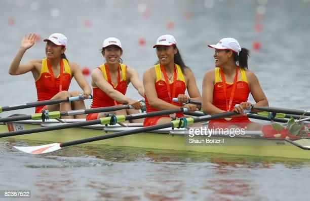 Tang Bin Jin Ziwei Xi Aihua and Zhang Yangyang of China celebrate their gold medal in the Women's Quadruple Sculls at the Shunyi Olympic...