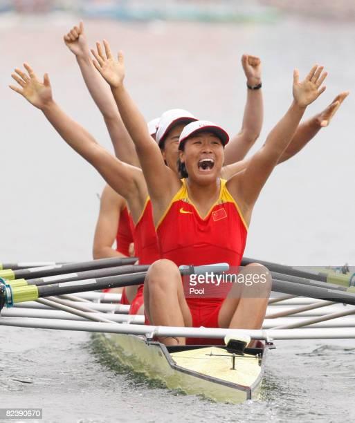 Tang Bin Jin Ziwei Xi Aihua and Zhang Yangyang of China celebrate their victory in the Women's Quadruple Sculls at the Shunyi Olympic RowingCanoeing...