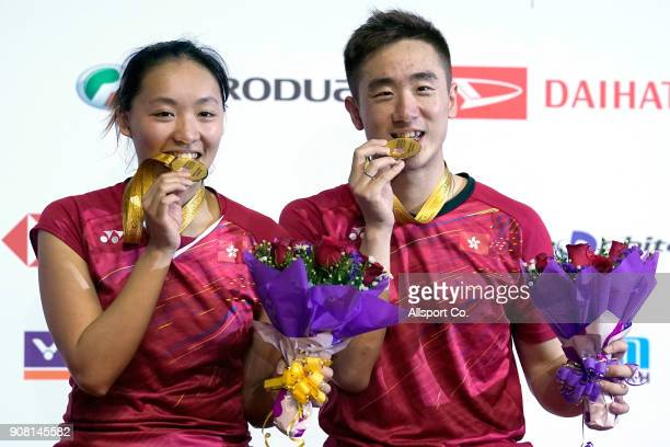Tang Chun Man and Tse Ying Suet of Hong Kong poses with their gold medals after they defeated Zheng Siwei and Huang Yaqiong of China in the Mixed...